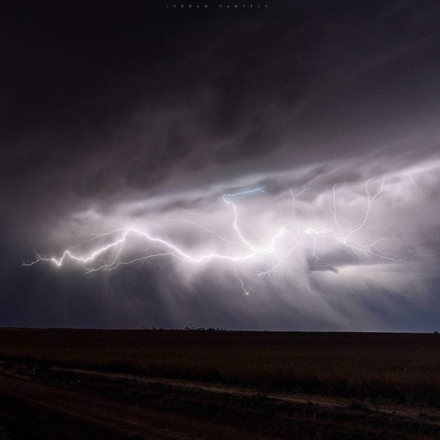 Streams of lightning appear from the clouds in what Ihellip
